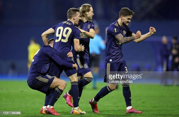 Dinamo Zagreb's players Croatian forward Mislav Orsic , Croatian midfiedler Lovro Majer and Slovenian defender Petar Stojanovic celebrate their 3-0...
