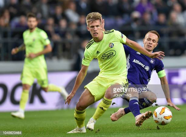 Dinamo Zagreb's Spanish midfielder Dani Olmo vies with Anderlecht's French Adrien Trebel during the Europa League Group D football match between...