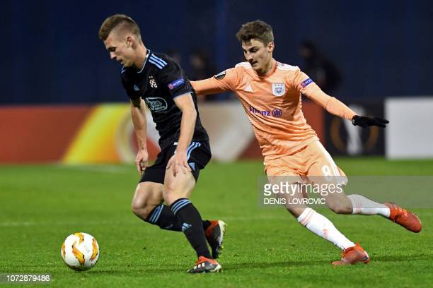 Dinamo Zagreb's Spanish midfielder Dani Olmo vies with Anderlecht's Belgian midfielder Pieter Gerkens during the UEFA Europa League Group D football...