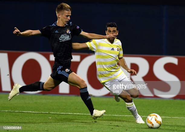 Dinamo's Dani Olmo fights for the ball with Fenerbahce's Ismail Koybasi during the Europa League Group D match between Dinamo Zagreb and Fenerbahce...