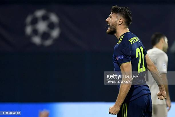 Dinamo's forward Bruno Petkovic celebrates after scoring a goal during UEFA Champions League Group C football match between Dinamo Zagreb and Shaktar...