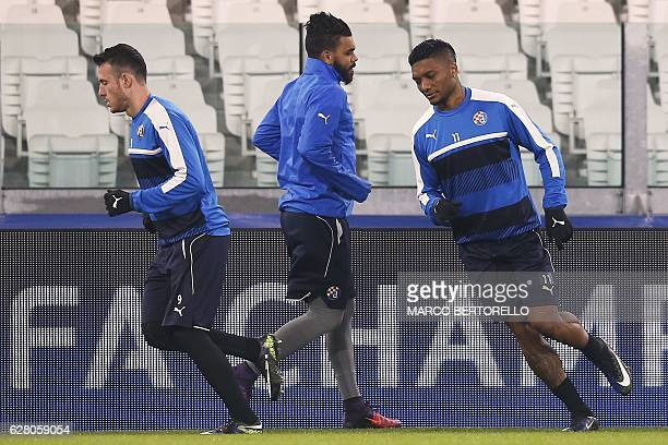 Dinamo's forward Junior Fernandes of Chile and Dinamo's forward Angelo Henriquez of Chile take part in a training session on the eve of the UEFA...