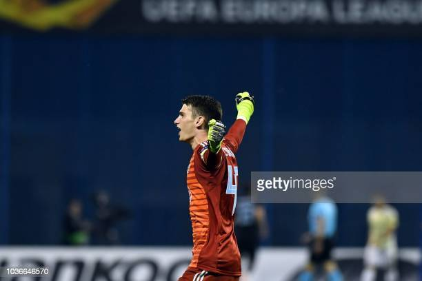 Dinamo's goalkeeper Dominik Livakovic celebrates after his team scored a goal during the Europa League group D match between Dinamo Zagreb and...