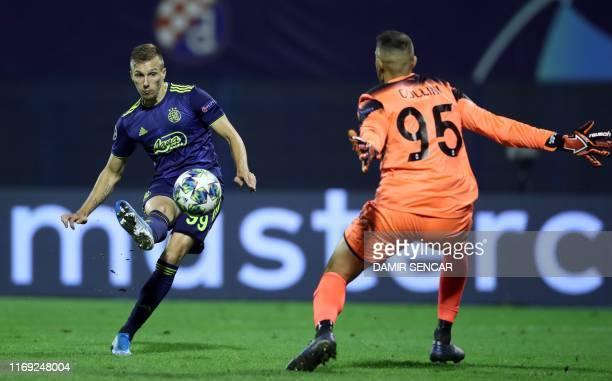Dinamo's Mislav Orsic scores a goal in front of Atalanta's goalkeeper Gollini Pierluigi during the UEFA Champions League Group C football match GNK...