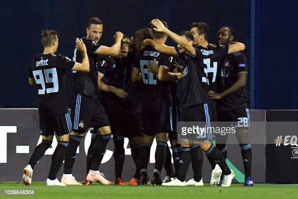 Dinamo's players celebrate after scoring a goal during the Europa League group D match between Dinamo Zagreb and Fenerbahce at the Maksimir stadium...