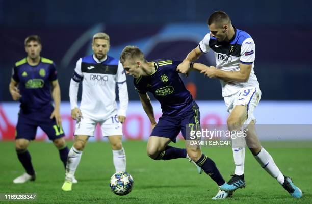 Dinamo's Spanish midfielder Dani Olmo and Atalanta's Colombian forward Luis Muriel fight for the ball during the UEFA Champions League Group C...