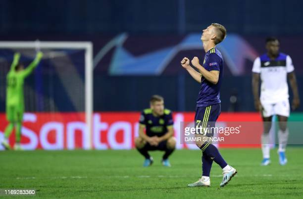 Dinamo's Spanish midfielder Dani Olmo celebrates his team's victory at the end of the UEFA Champions League Group C football match GNK Dinamo vs...