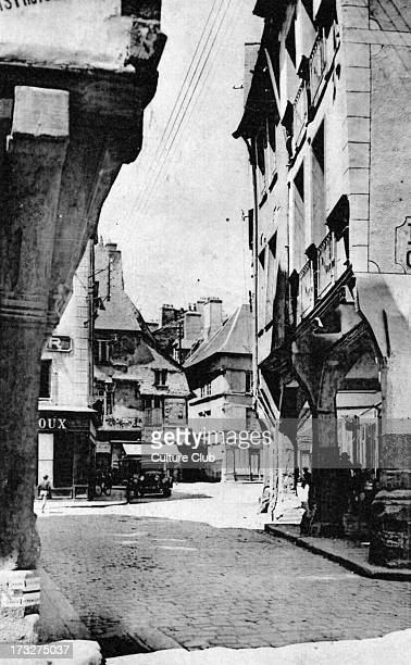 the picturesque Rue de L'Apport Medieval town on a hilltop with many old atmospheric buildings going back to 13th century Postcard