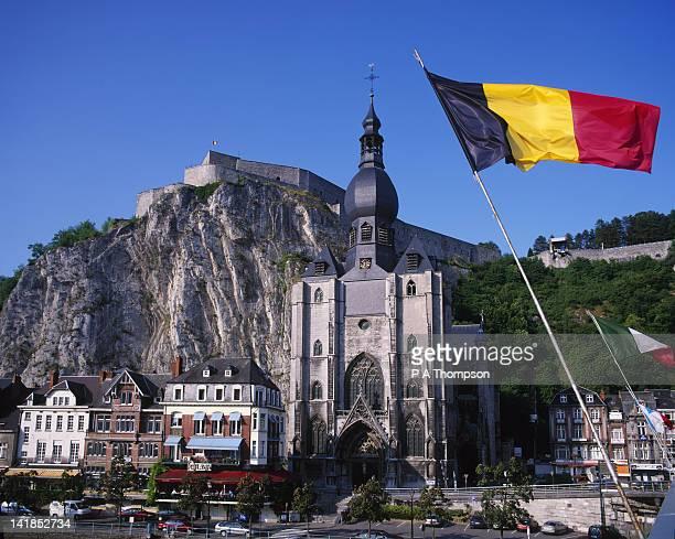 dinant and belgian flag, ardennes, belgium - ナミュール州 ストックフォトと画像