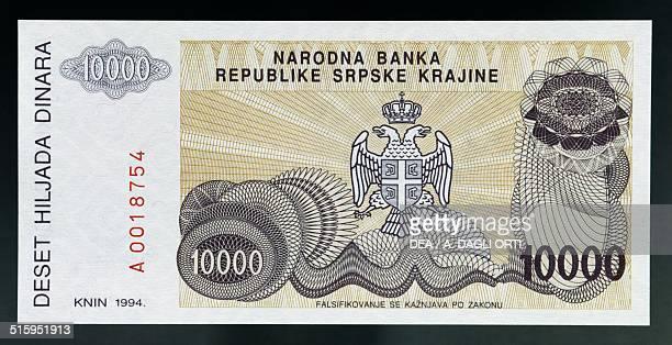 10000 dinar banknote reverse twoheaded eagle coat of arms Republic of Serbian Krajina in Croatia 20th century