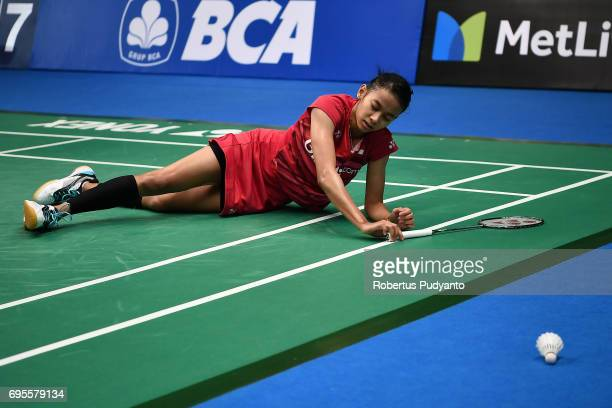 Dinar Dyah Ayustine of Indonesia falls during the game against Sung Ji Hyun of Korea in the Womens Single Round 1 match of the BCA Indonesia Open...