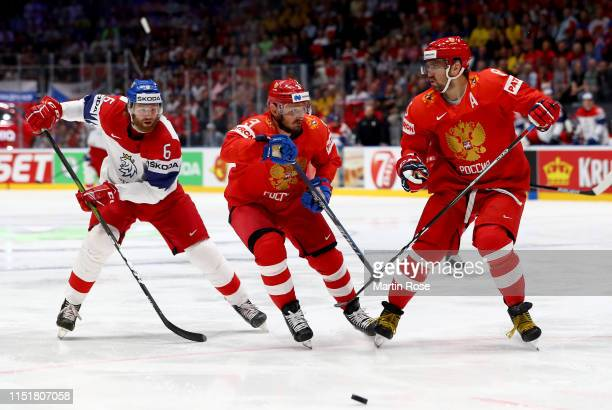 Dinar Khafizullin and Alexander Ovechkin of Russia challenge David Musil of Czech Republic during the 2019 IIHF Ice Hockey World Championship...