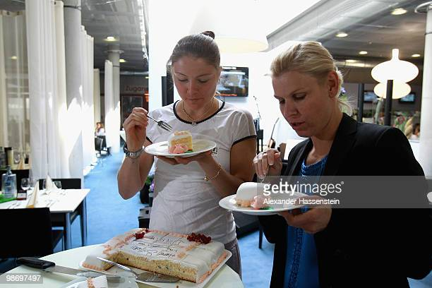 Dinara Michailowna Safina enjoys a birthday cake for her todays 24th birthday with Anke Huber during day tow of the WTA Porsche Tennis Grand Prix...