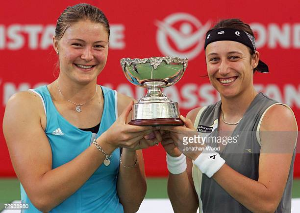 Dinara Safina of Russia and playing partner Katarina Srebotnik of Slovakia pose with the winners trophy after their final doubles match against Iveta...