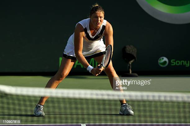 Dinara Safina of Russia gets set to return serve against Vera Zvonareva of Russia during the Sony Ericsson Open at Crandon Park Tennis Center on...