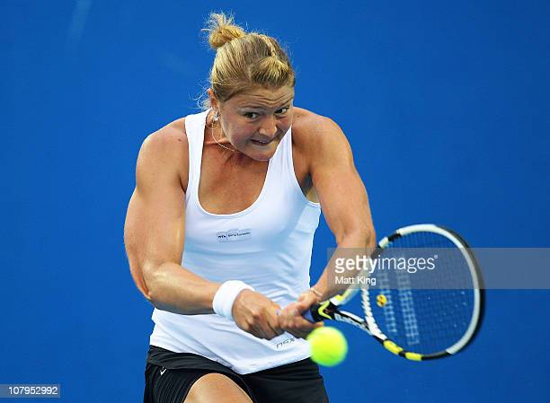 Dinara Safina of Russia plays a backhand during her 1st round match against Marion Bartoli of France during day two of the Moorilla Hobart...