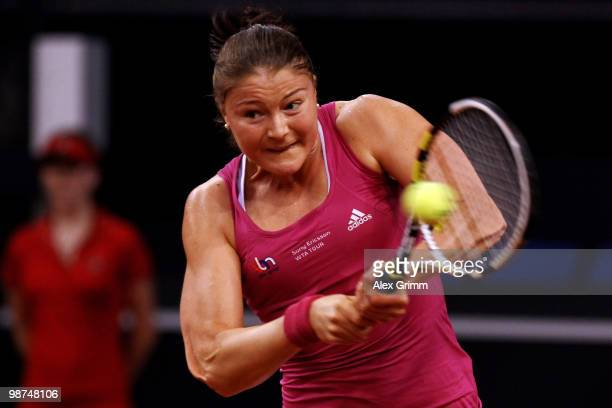 Dinara Safina of Russia plays a backhand during her second round match against Agnes Szavay of Hungary at day four of the WTA Porsche Tennis Grand...