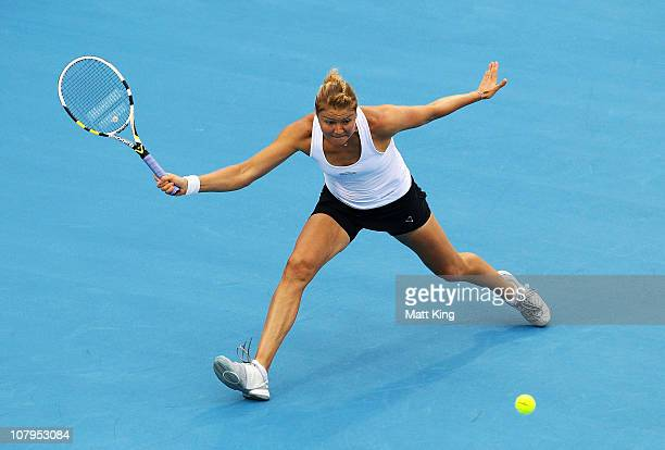 Dinara Safina of Russia plays a forehand during her 1st round match against Marion Bartoli of France during day two of the Moorilla Hobart...