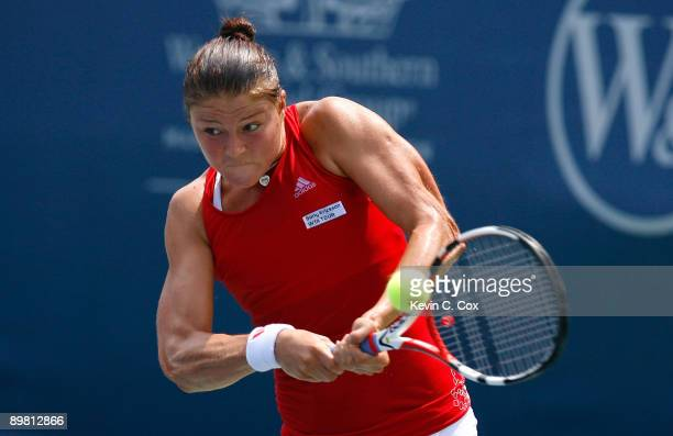 Dinara Safina of Russia returns a shot to Flavia Pennetta of Italy in the semifinals of the Western Southern Financial Group Women's Open on August...