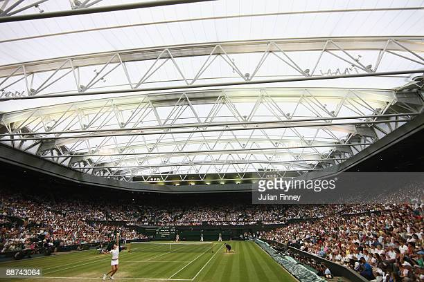 Dinara Safina of Russia serves during the women's singles fourth round match against Amelie Mauresmo of France on Day Seven of the Wimbledon Lawn...