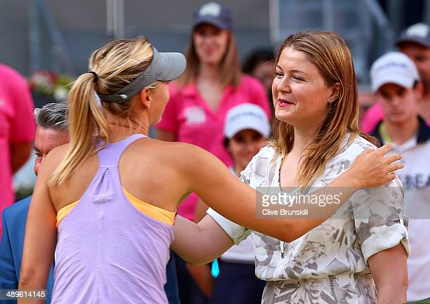 Dinara Safina of Russia with Maria Sharapova of Russia after announcing her retirement from the WTA Tour after the prize giving ceremony for Maria...