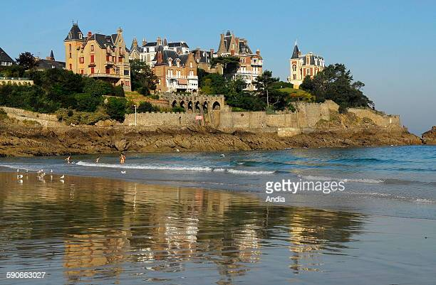 "Dinard Villas on the seaside in the area of the ""pointe de la Malouine"" headland and beach of ""l'Ecluse"". Swimmers and sea gulls"