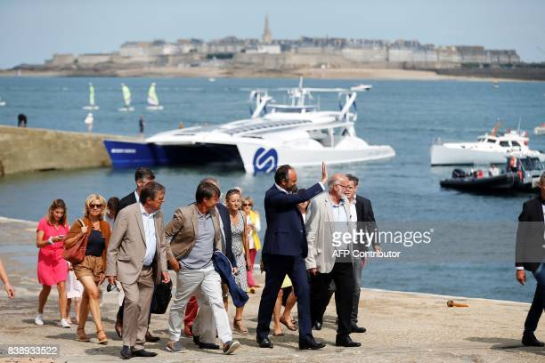 Dinard's mayor JeanClaude Mahe welcomes French Prime Minister Edouard Philippe and Ecology Minister Nicolas Hulot as they disembark the selfenergy...