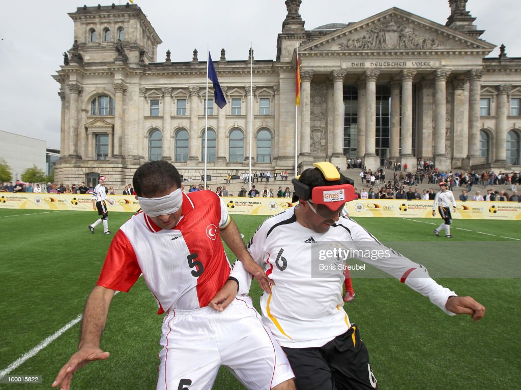 Dinc Cengiz (R) of Germany battles for the ball with a player of Turkey during the Blind Football National match between Germany and Turkey on the �Day of Blind Football� in front of the Reichstag on May 20, 2010 in Berlin, Germany.