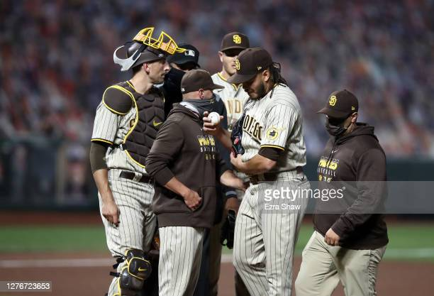 Dinelson Lamet of the San Diego Padres is taken out of the game against the San Francisco Giants with an injury in the fourth inning of game two of...