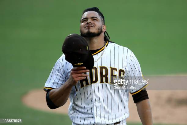 Dinelson Lamet of the San Diego Padres walks off the mound during the third inning of a game against the Arizona Diamondbacks at PETCO Park on July...