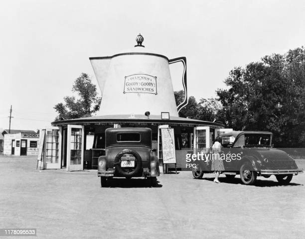 A diner in the shape of a giant coffee pot selling 'Delicious Goody Goody Sandwiches' in Phoenix Arizona circa 1930
