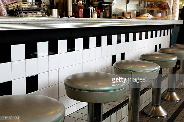 diner-piped green counter stools