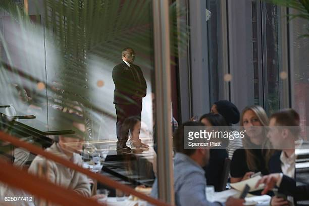 Diners and members of the Secret Service wait for Presidentelect Donald Trump to walk through the lobby of the New York Times following a meeting...