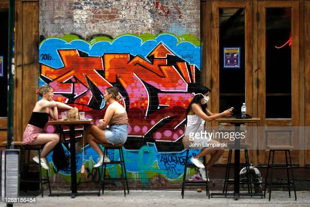 Diners are seated outdoors at a restaurant on the street in East Village as re-opening continues across densely populated New York and New Jersey...