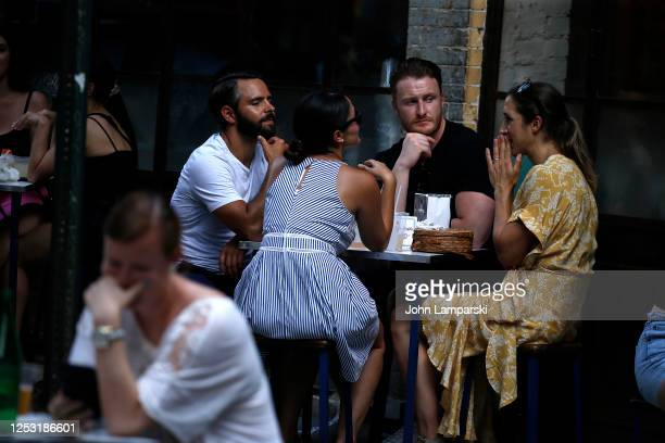Diners are seated outdoors at a restaurant on the street in West Village as re-opening continues across densely populated New York and New Jersey...