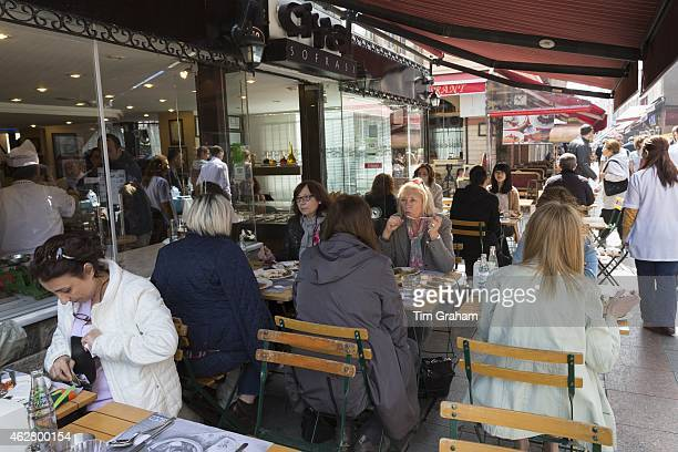 Diners at Ciya Sofrasi Turkish restaurant by food market in Kadikoy district on Asian side of Istanbul East Turkey