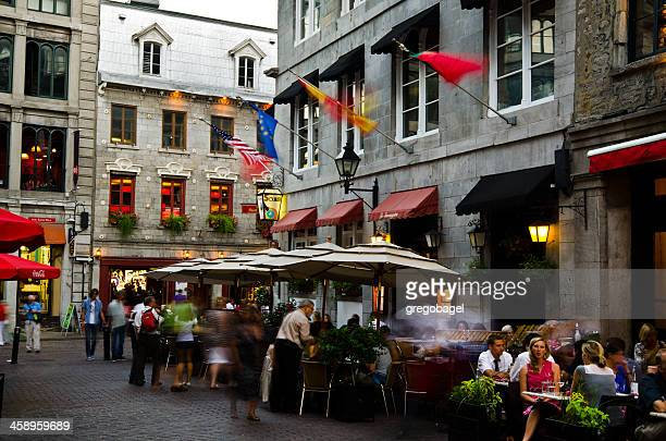 diners at restaurant on patio in old montreal, quebec - vieux montréal stock pictures, royalty-free photos & images