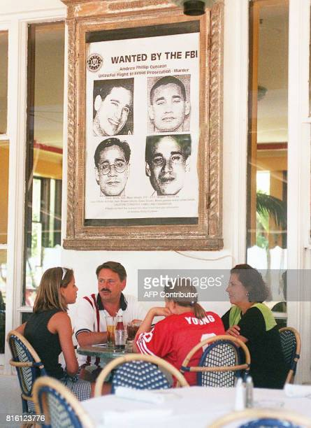 Diners at the Edgewater Hotel on Miami Beach sit under a large wanted poster of Andrew Cunanan 23 July. Cunanan is wanted for the 15 July killing of...