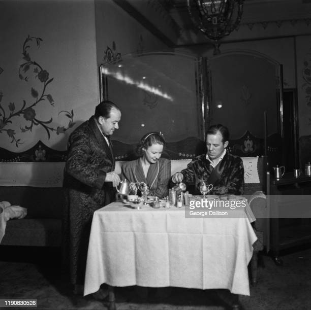 Diners at the Hungaria a Hungarian restaurant on Lower Regent Street in London which also acts as an air raid shelter with beds for its patrons...