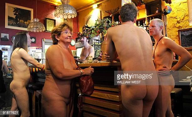 Diners at the Naked Brunch an event designed for the Melbourne Fringe Festival order drinks at the bar in Melbourne on October 6 2009 Designed as a...