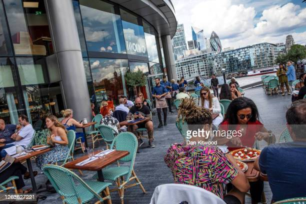 Diners at the Tavolino restaurant in the London Bridge area on August 03 2020 in London England Throughout August the British government will...