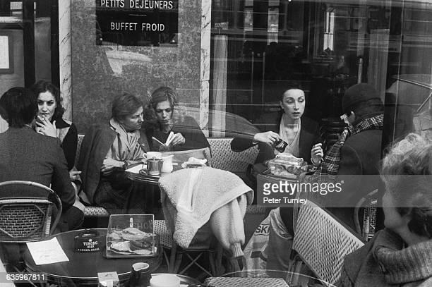 Diners crowd the Cafe de Flore in Paris