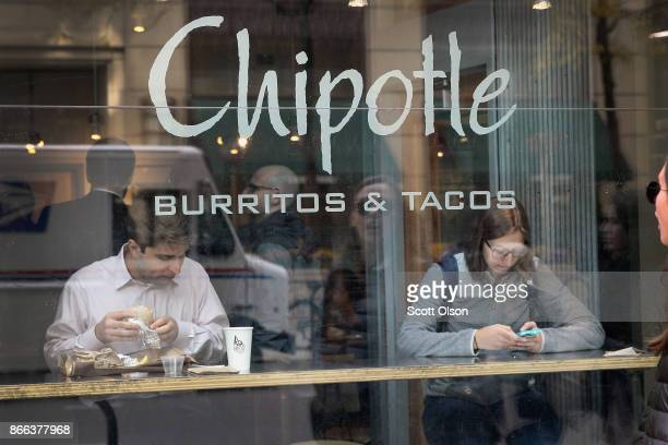 Diners eat at a Chipotle restaurant on October 25 2017 in Chicago Illinois Chipotle stock fell more than 14 percent today after a weak 3Q earnings