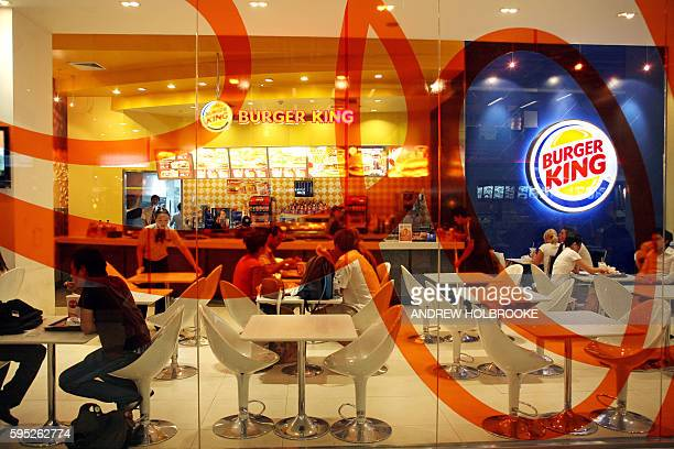 Diners eat in Burger King The giant fastfood multinational American restaurant chain has expanded its presence overseas