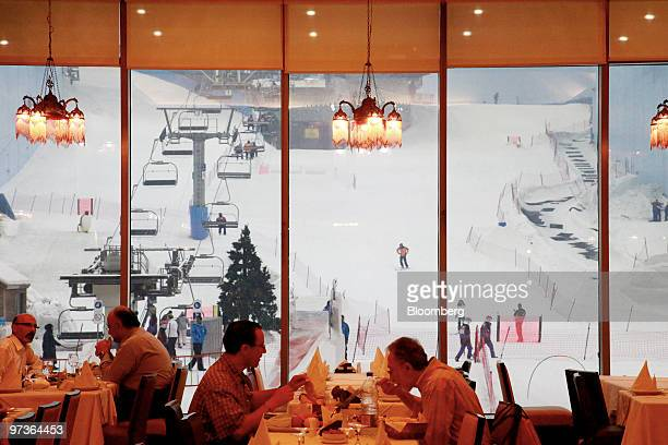 Diners eat overlooking the indoor ski slope at the Mall of the Emirates in Dubai United Arab Emirates on Monday March 1 2010 The United Arab Emirates...
