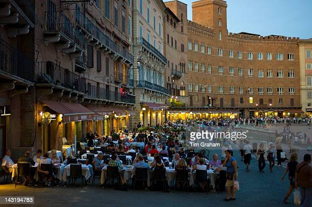 Diners eating al fresco at Nannini bar and restaurant in Piazza del Campo Siena Italy