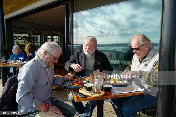 Diners enjoy an alfresco breakfast on the terrace at the Indidog brasserie, as outdoor hospitality restarts on April 12, 2021 in Falmouth, England....