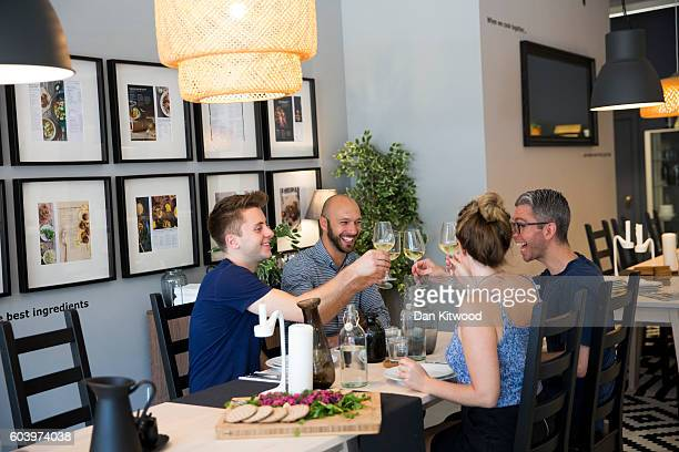 Diners enjoy lunch after cooking it inside Ikea's 'The Dining Club' pop up restaurant cafe and shop in Shoreditch on September 13 2016 in London...