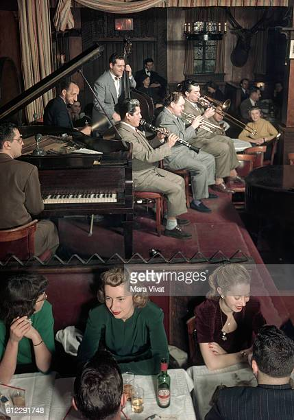 Diners enjoy the music of a jazz band at Dixieland Nicks in Greenwich Village New York City 1950 | Location Dixieland Nicks Greenwich Village New...