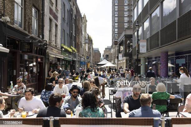 Diners in an outdoor eating area in Soho in London, U.K., on Saturday, June 5, 2021. Carnaby Street is the heart of British fashion, home to the...